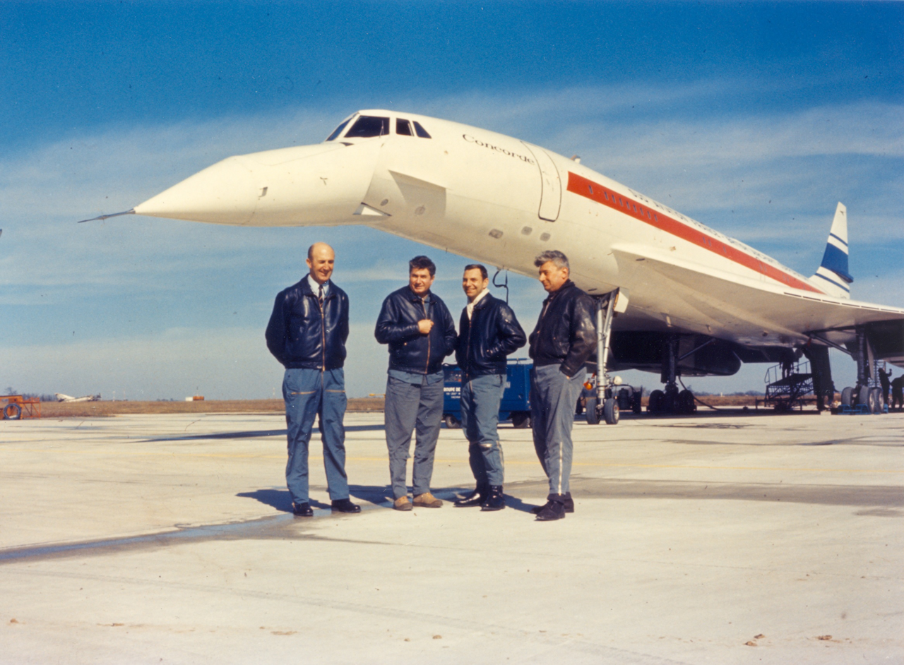 The flight crew for the Concorde's supersonic airliner's maiden flight mark the occasion with a group photo.