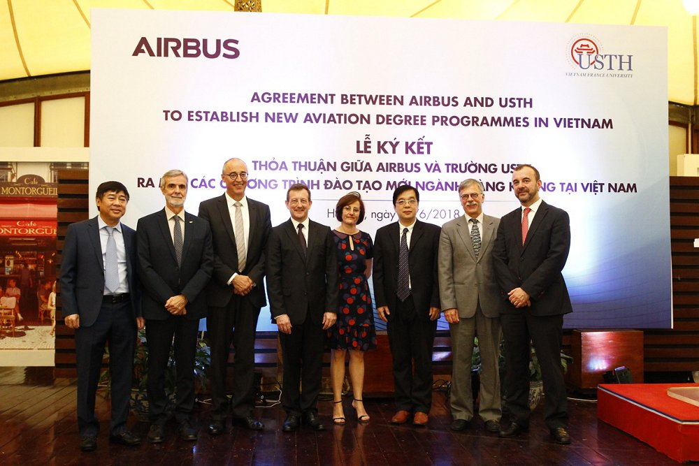 Members of Airbus and the University of Science and Technology of Hanoi mark an agreement to collaborate on new degree programmes.