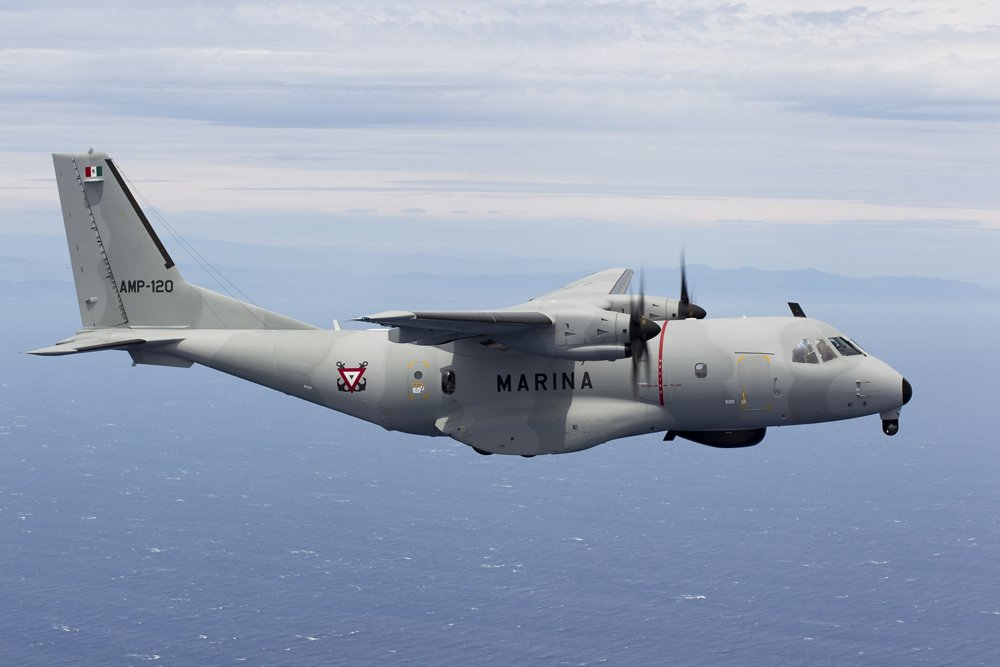 An in-flight C295W transport aircraft operated by the Mexican Navy flies over water.