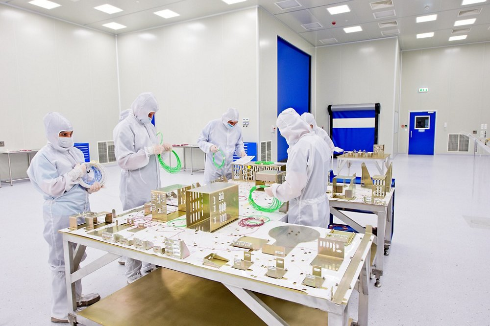 A view of workers inside Airbus' Warsaw, Poland clean room facility used for manufacturing spaceflight components and spacecraft integration.