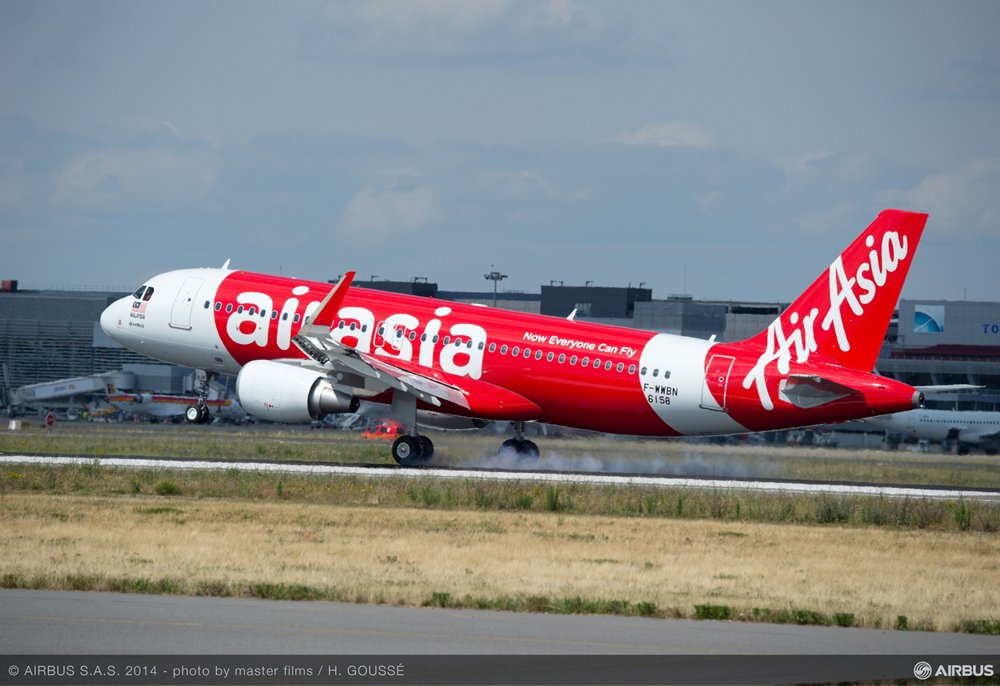 An A320neo operated by AirAsia begins its takeoff from a runway.