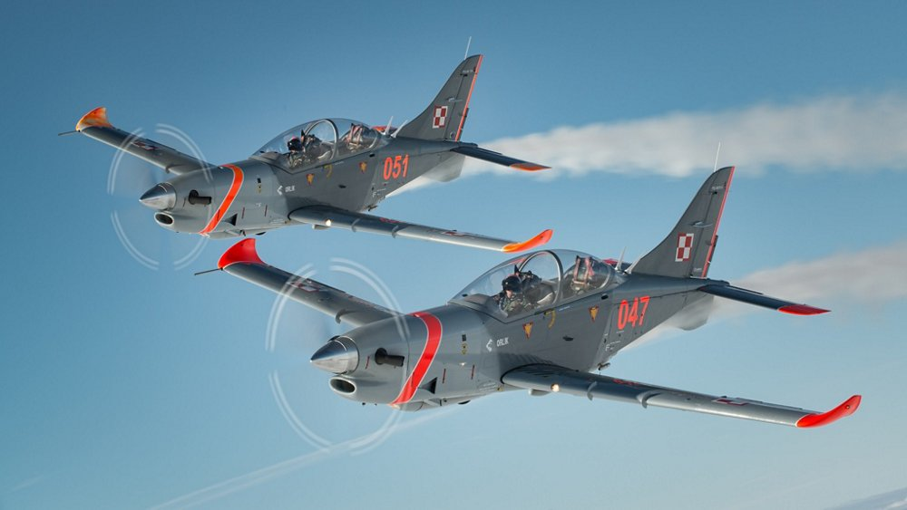 Two in-flight PZL-130 Orlik aircraft, which are manufactured at Airbus' production facility in Warsaw, Poland.