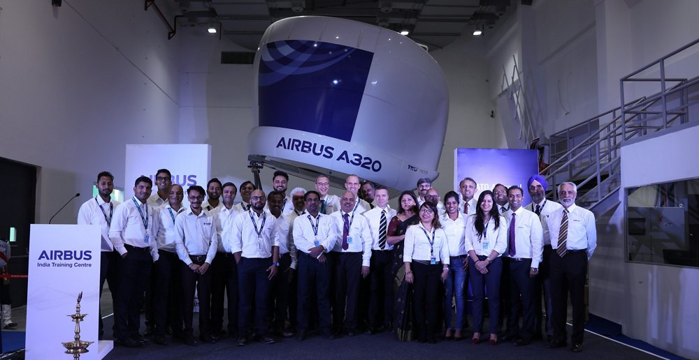 Pilots and maintenance engineers mark the inauguration of Airbus' training centre in Bengaluru, India with a group photo.