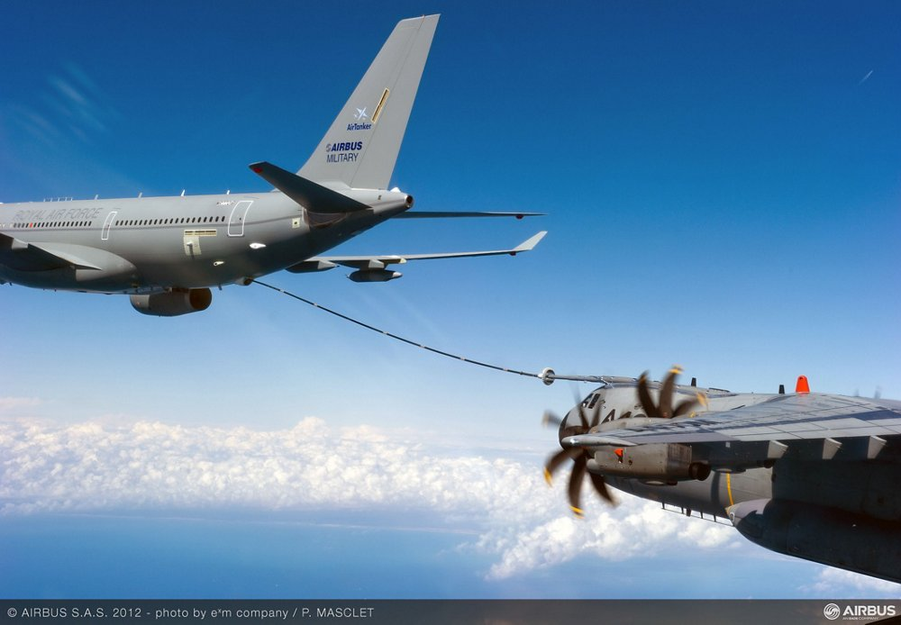 An in-flight A330 Multi Role Tanker Transport uses its Fuselage Refuelling Unit to transfer fuel to an A400M military airlifter.