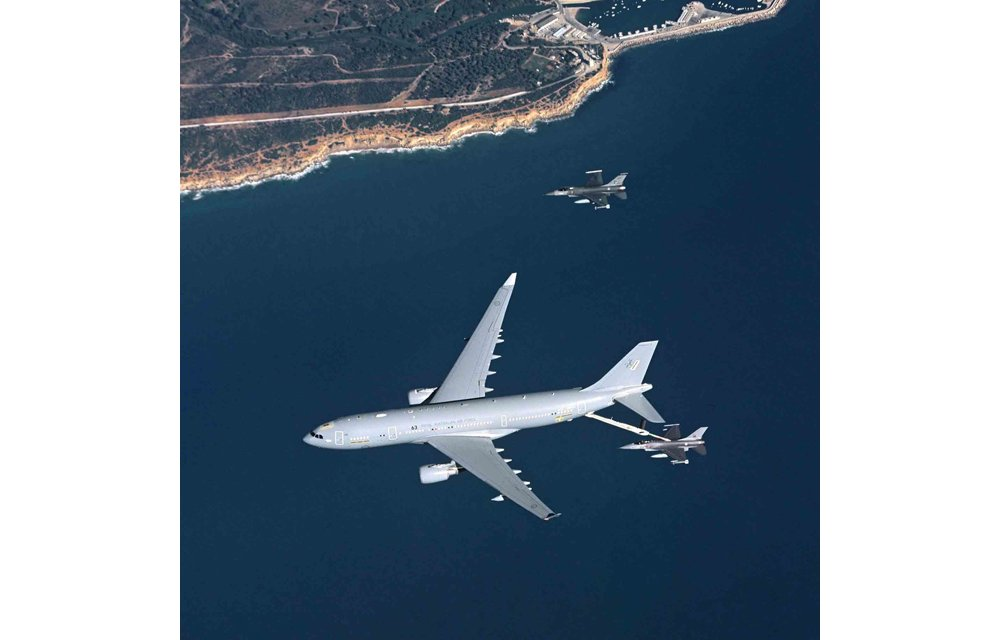 An in-flight A330 Multi Role Tanker Transport refuels a fighter aircraft using its Aerial Refuelling Boom System (ARBS).