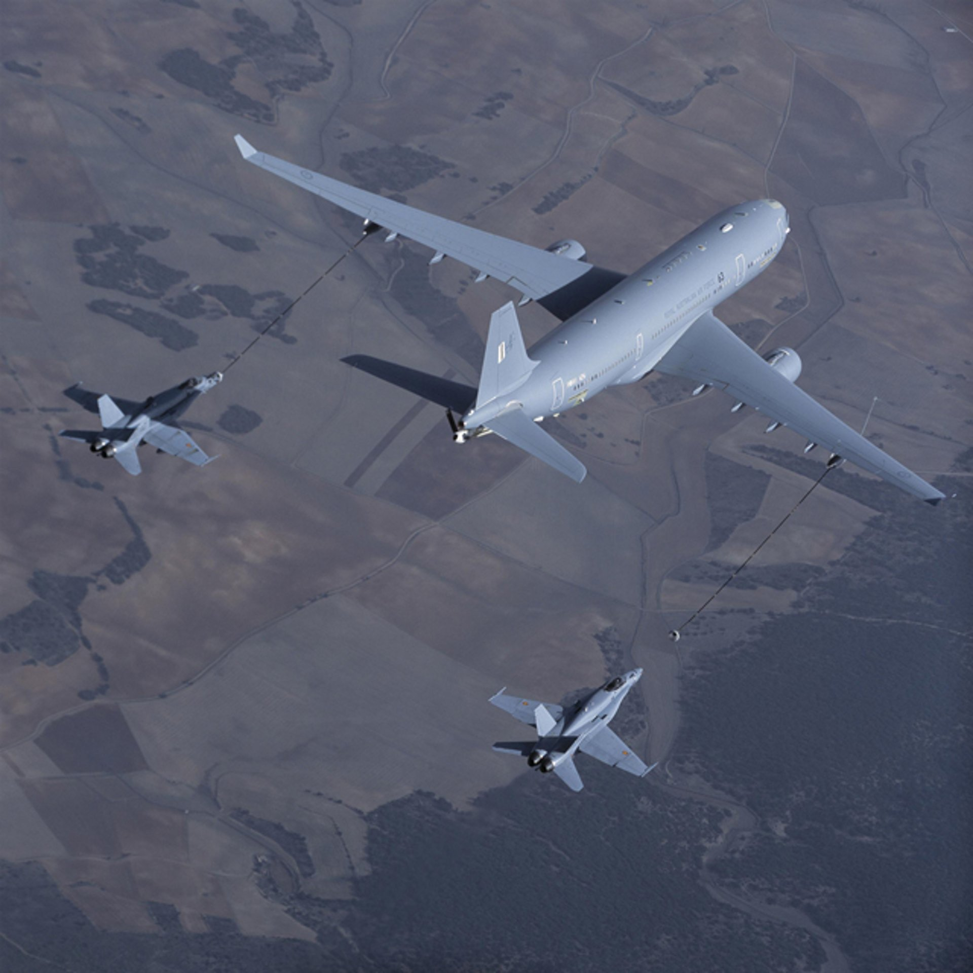 An A330 Multi Role Tanker Transport performs a refuelling evaluation mission with two fighter aircraft.