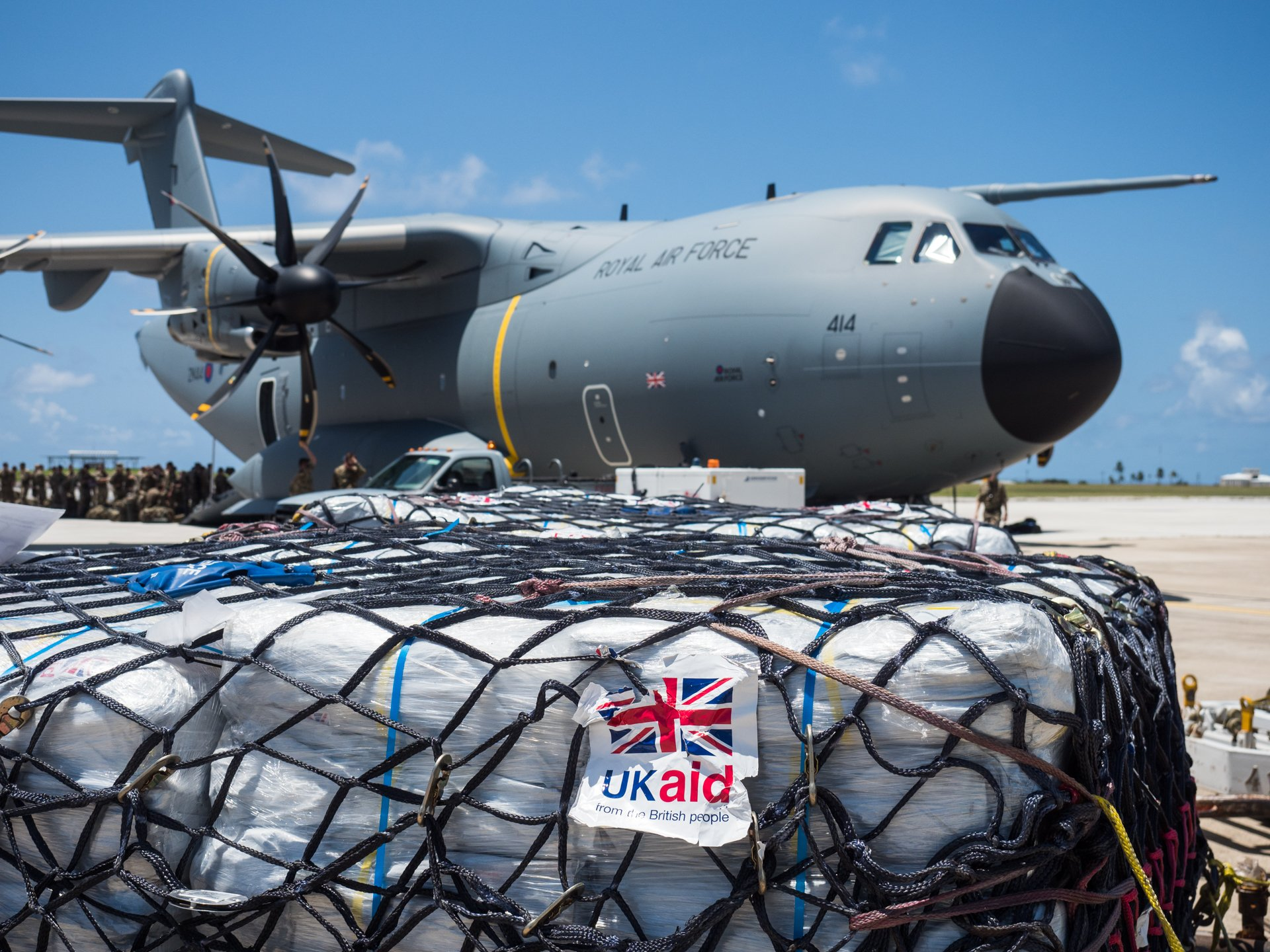 UK military passengers board an RAF A400M Atlas transport aircraft in Barbados on 9 September 2017, preparing to deliver UK aid to Caribbean islands stricken by Hurricane Irma.