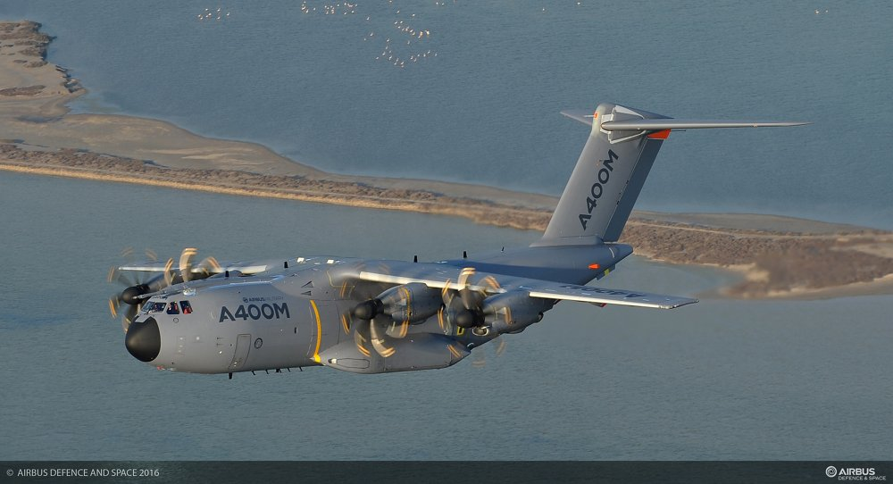 Side view of an in-flight A400M military airlifter.
