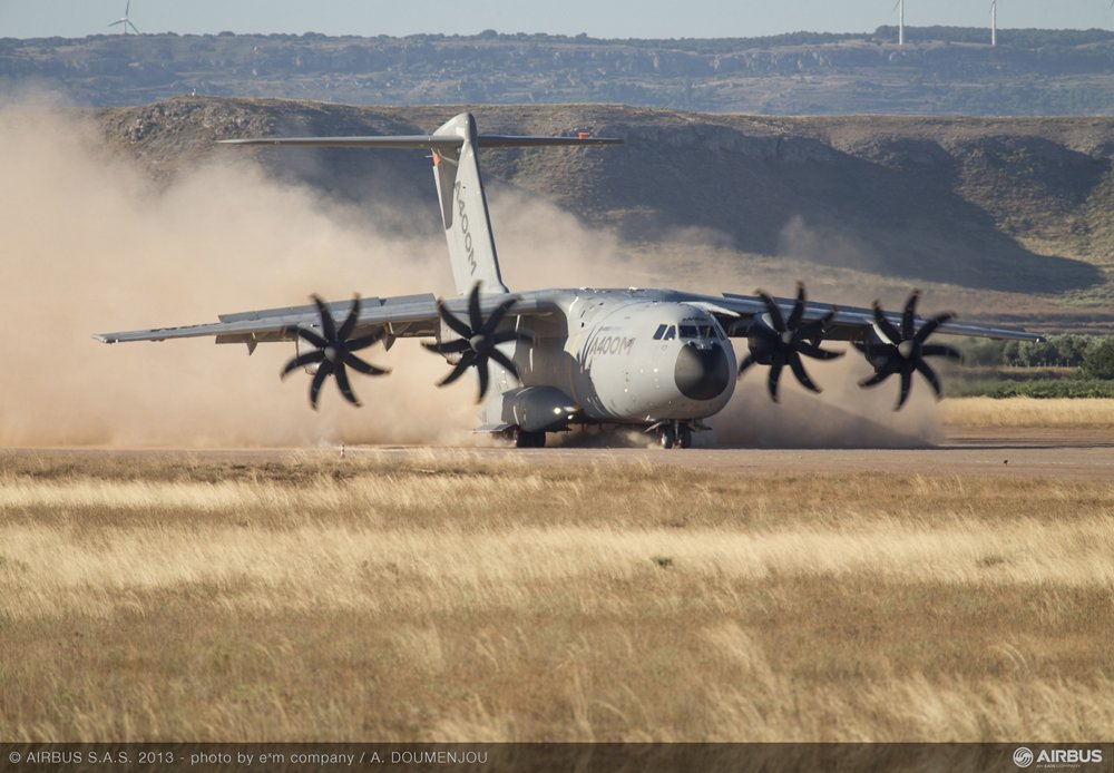 The A400M military airlifter lands on a short, unpaved airstrip.