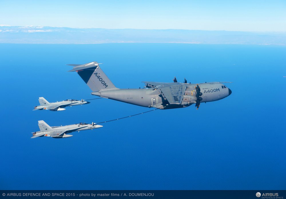 The A400M military airlifter refuels two receiver aircraft using its hose and drogue under-wing refuelling pods.