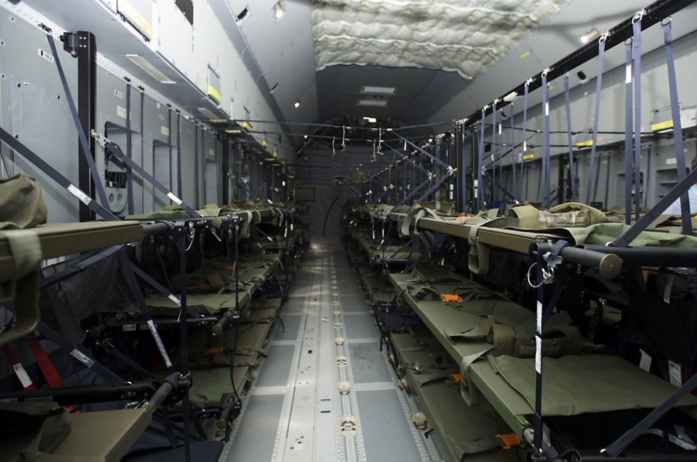 A view inside an A400M military airlifter's cargo area configured for medical evacuation operations.