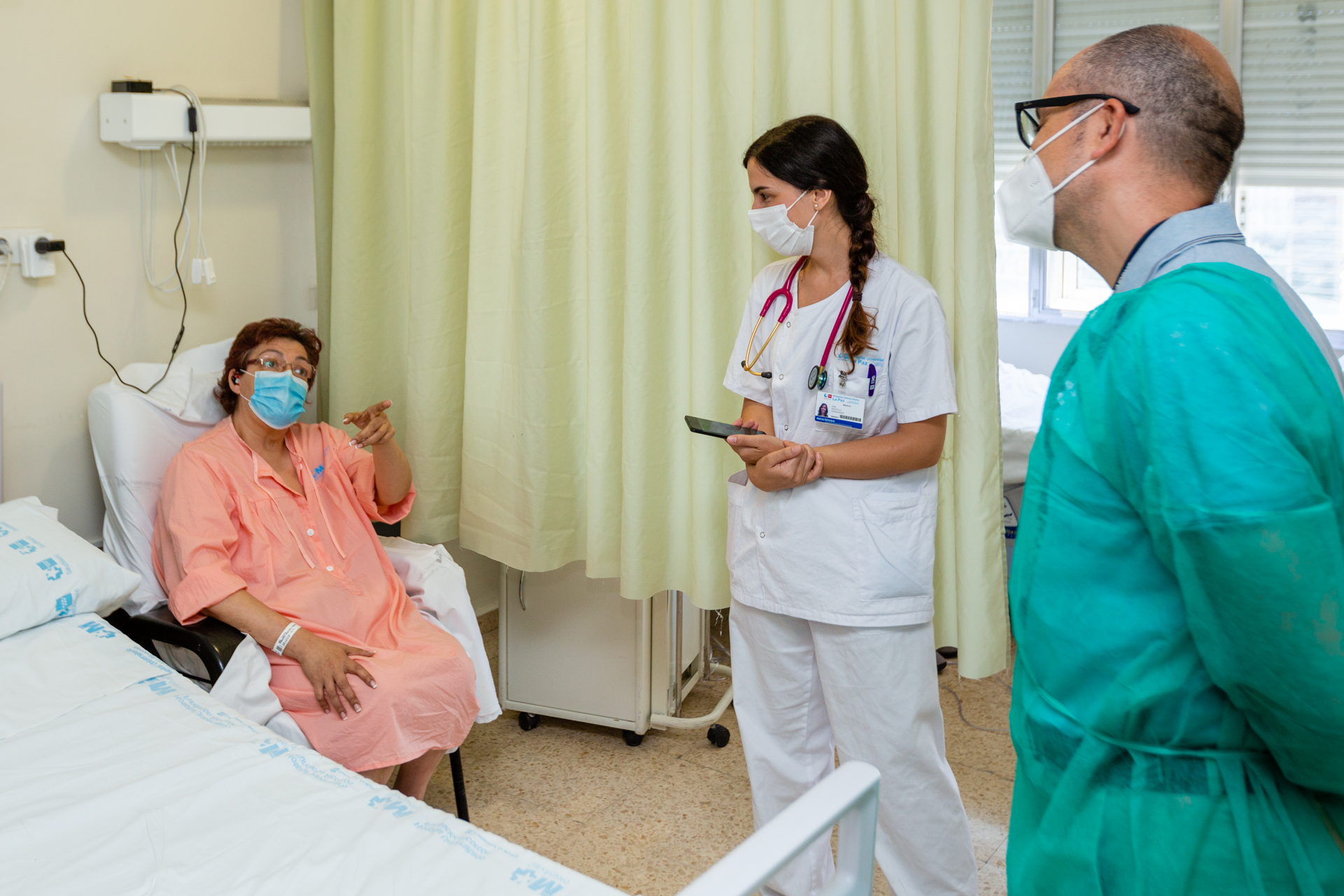 Medical personnel meet with a patient utilising Airbus' Smart Flying Hospital health monitoring system.