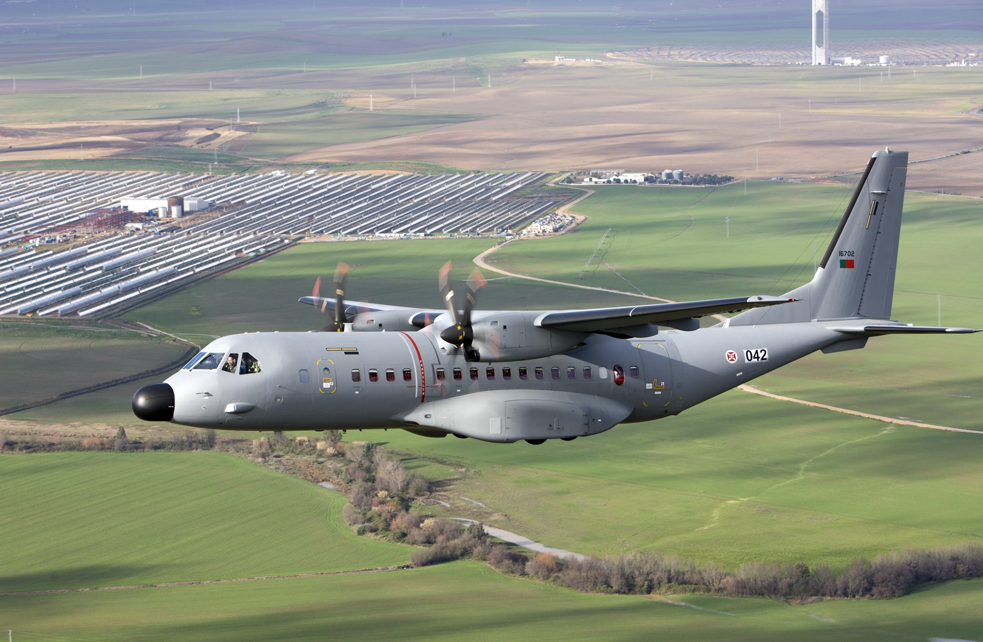 Side view of an in-flight Airbus C295 transport aircraft.