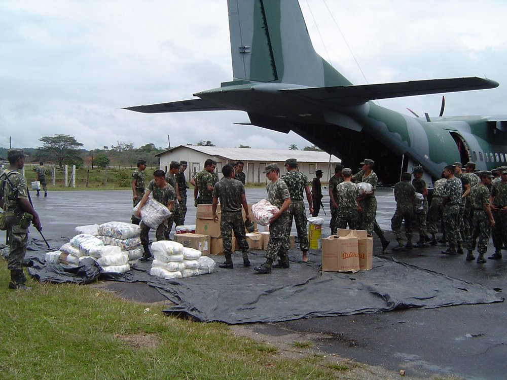 Humanitarian relief supplies are unloaded by military personnel from a C295 transport aircraft.