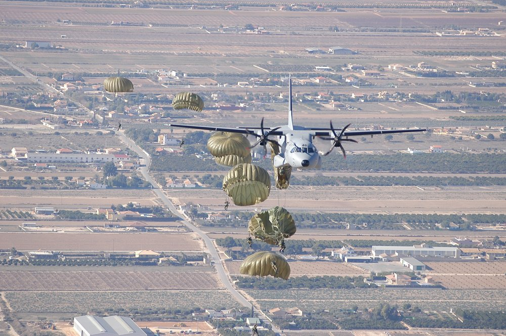 Paratroopers are deployed from an in-flight Airbus C295 transport aircraft.