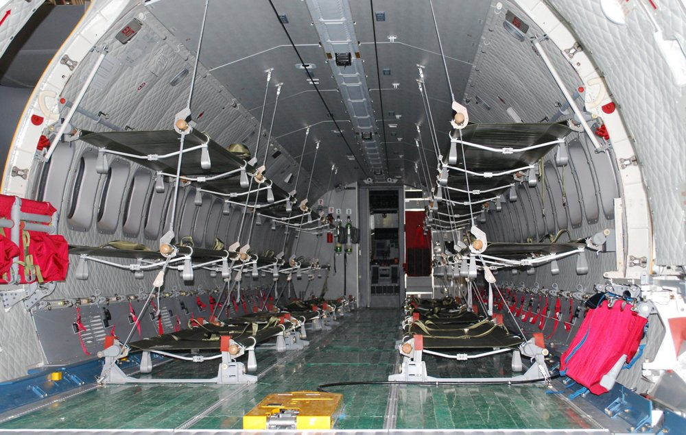 A view inside a C295 transport aircraft cabin equipped for medical evacuation missions.