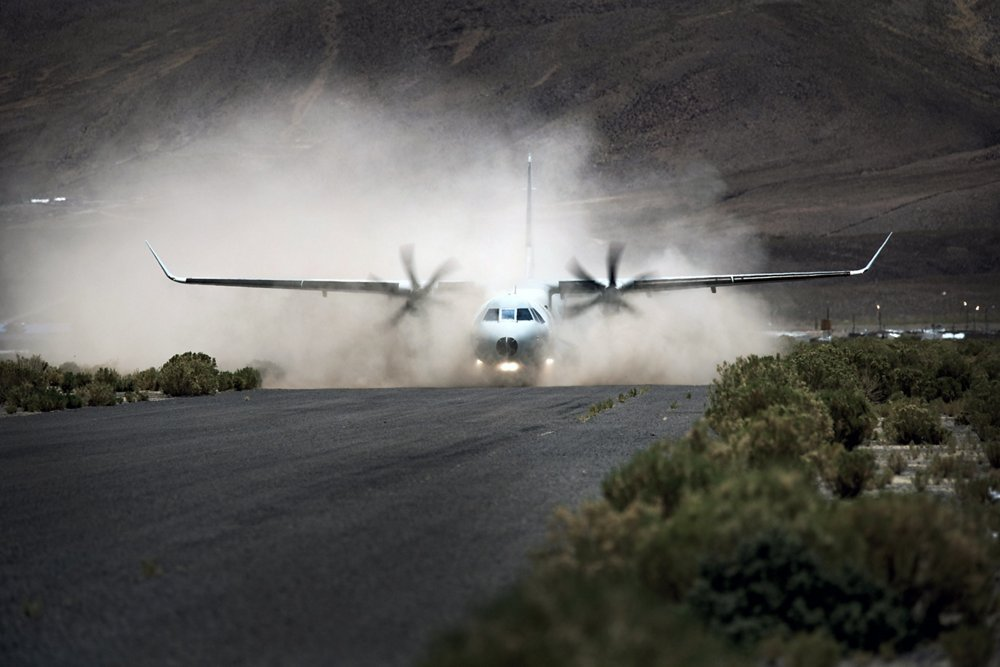An Airbus C295 transport aircraft begins its take-off off from a semi-prepared airstrip.