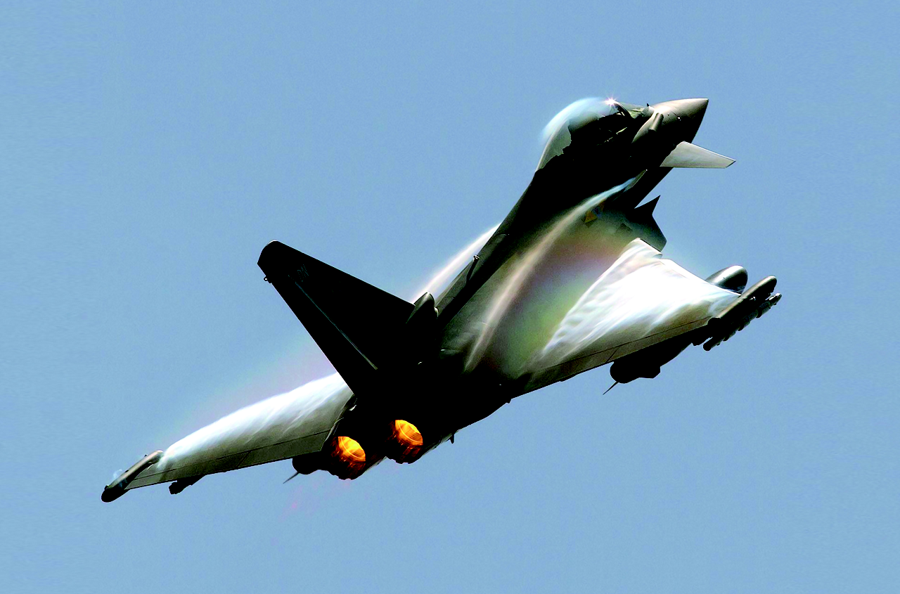 An in-flight Eurofighter Typhoon aircraft ascends.