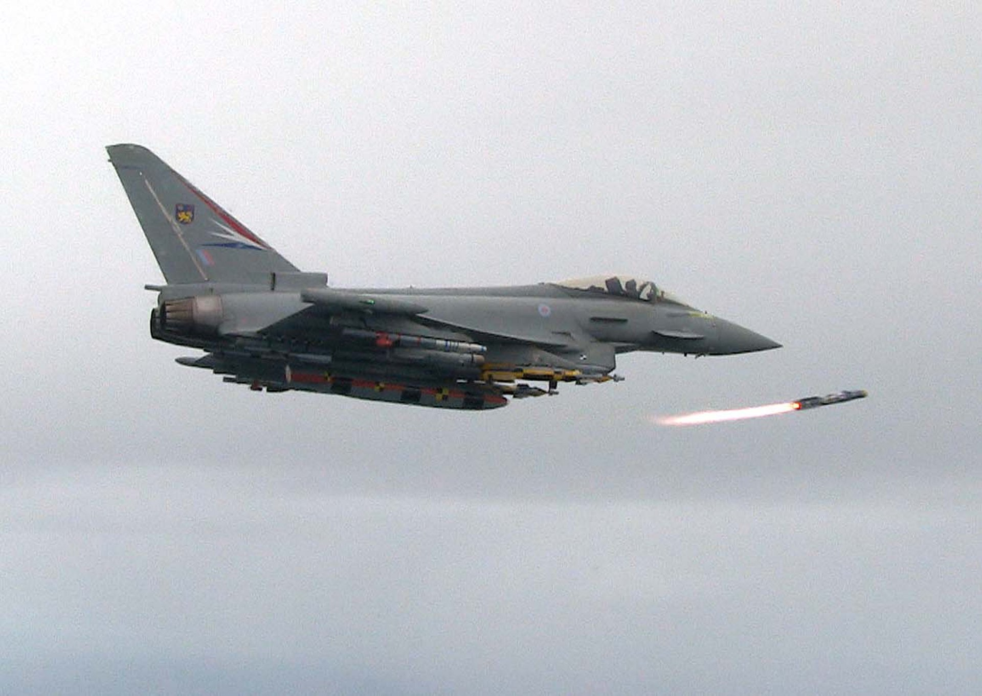 A Eurofighter Typhoon swing-role fighter aircraft launches an air-to-air missile.