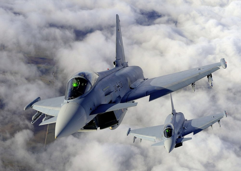 Two Eurofighter aircraft are shown flying in formation.