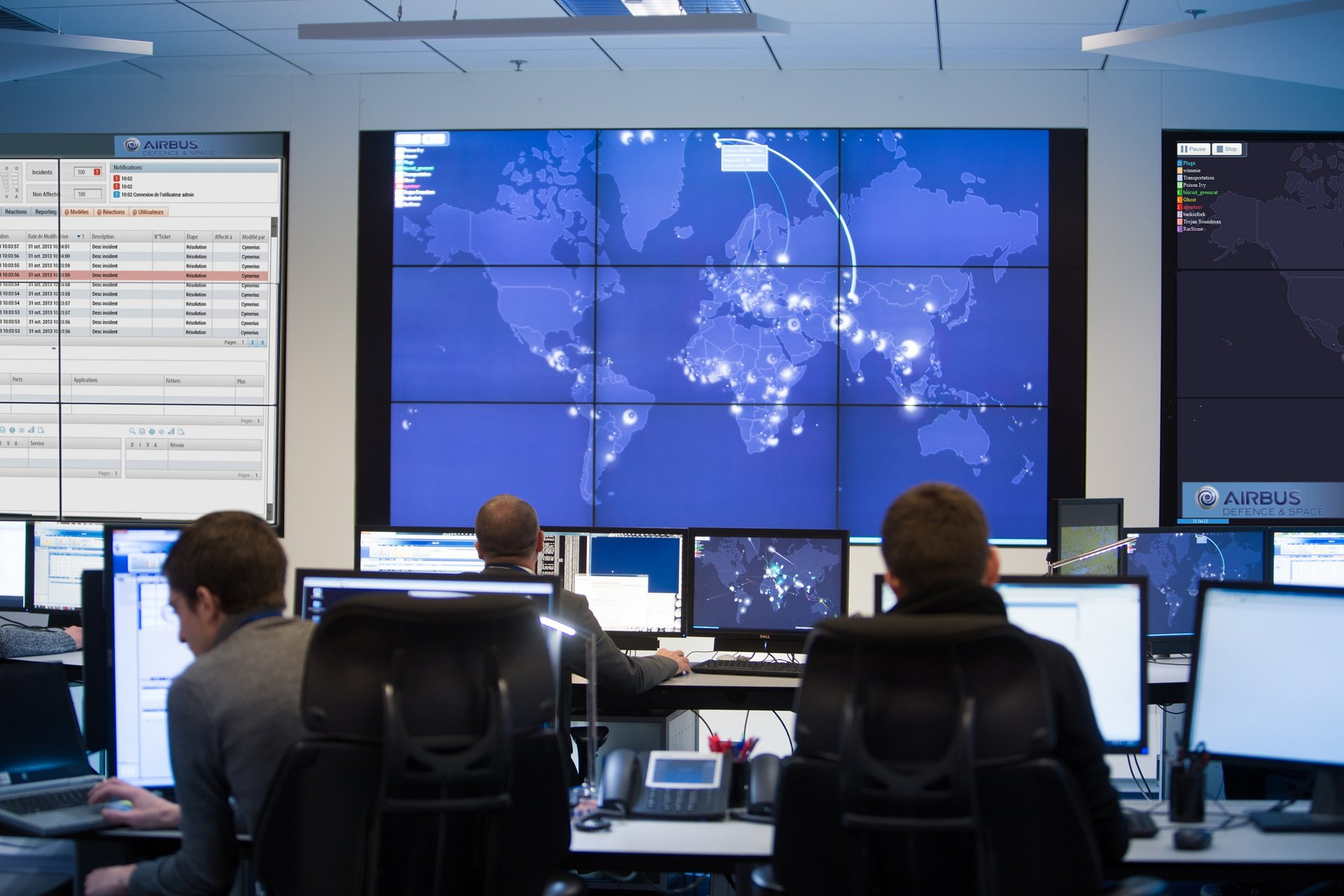 A view of personnel and systems in a border security command and control centre.