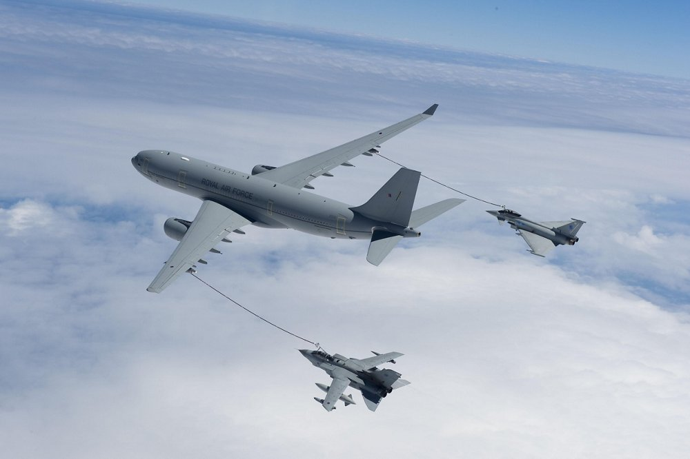 The Airbus A330 Multi Role Tanker Transport (MRTT) delivers fuel to two receiver aircraft using its hose and drogue under-wing refuelling pods.