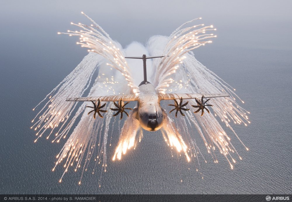An A400M military airlifter deploys chaff and flare during an in-flight evaluation.