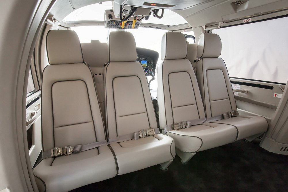 A row of passenger seats inside an Airbus AS365 N3+ helicopter