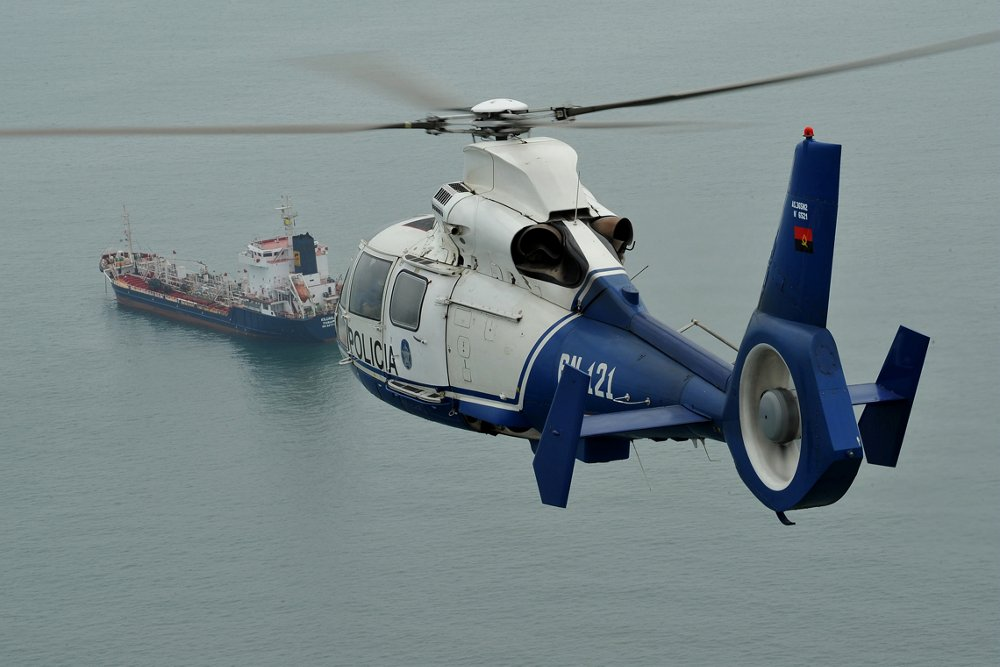 An in-flight AS365 N3+ helicopter configured for oil and gas transport services.