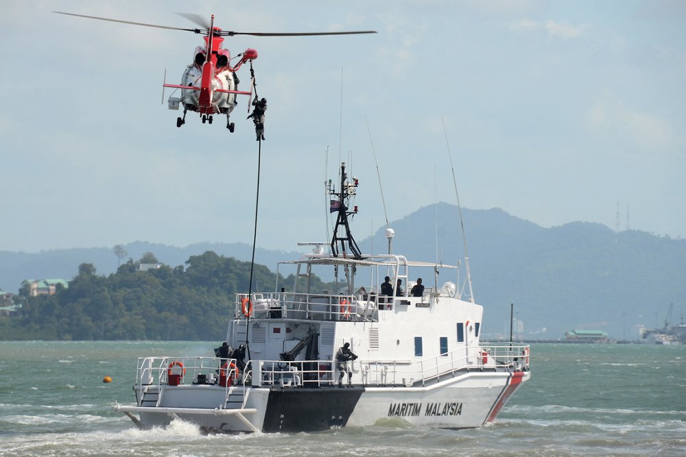 The hoist system is deployed by an Airbus AS365 N3+ helicopter configured for coast guard and enforcement operations.