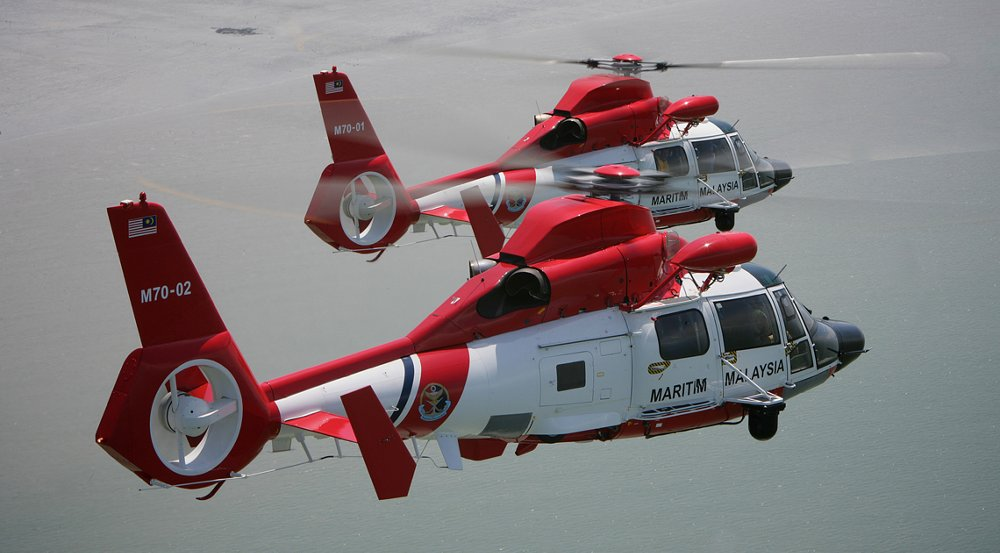 Two AS365 N3+ helicopters fly side-by-side in coast guard service