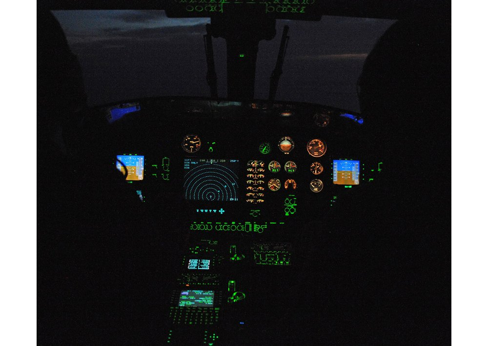 A view of the flight deck inside an Airbus AS565 MBe military helicopter's cockpit.