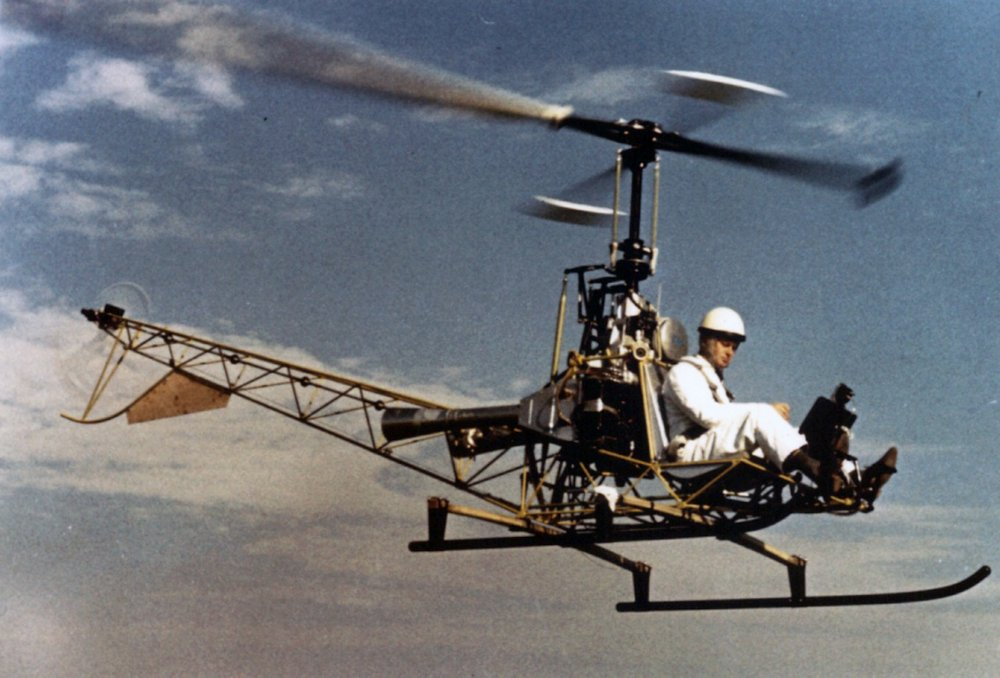 The Bo103 experimental helicopter is shown in flight.