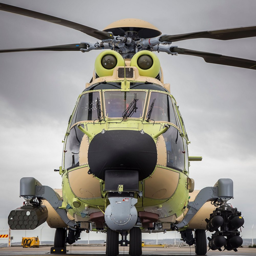 A head-on view of an on-ground NH90 military helicopter configured with Airbus' HForce onboard weapon system.