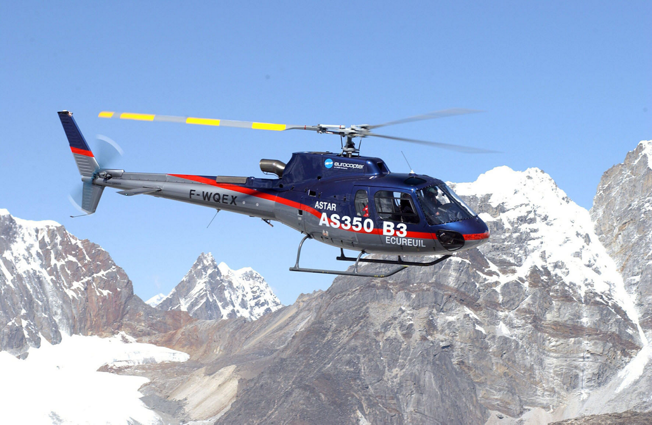 Piloted by Didier Delsalle, an Airbus AS350 helicopter (later re-designated the H125) flies over Mount Everest in 2005.