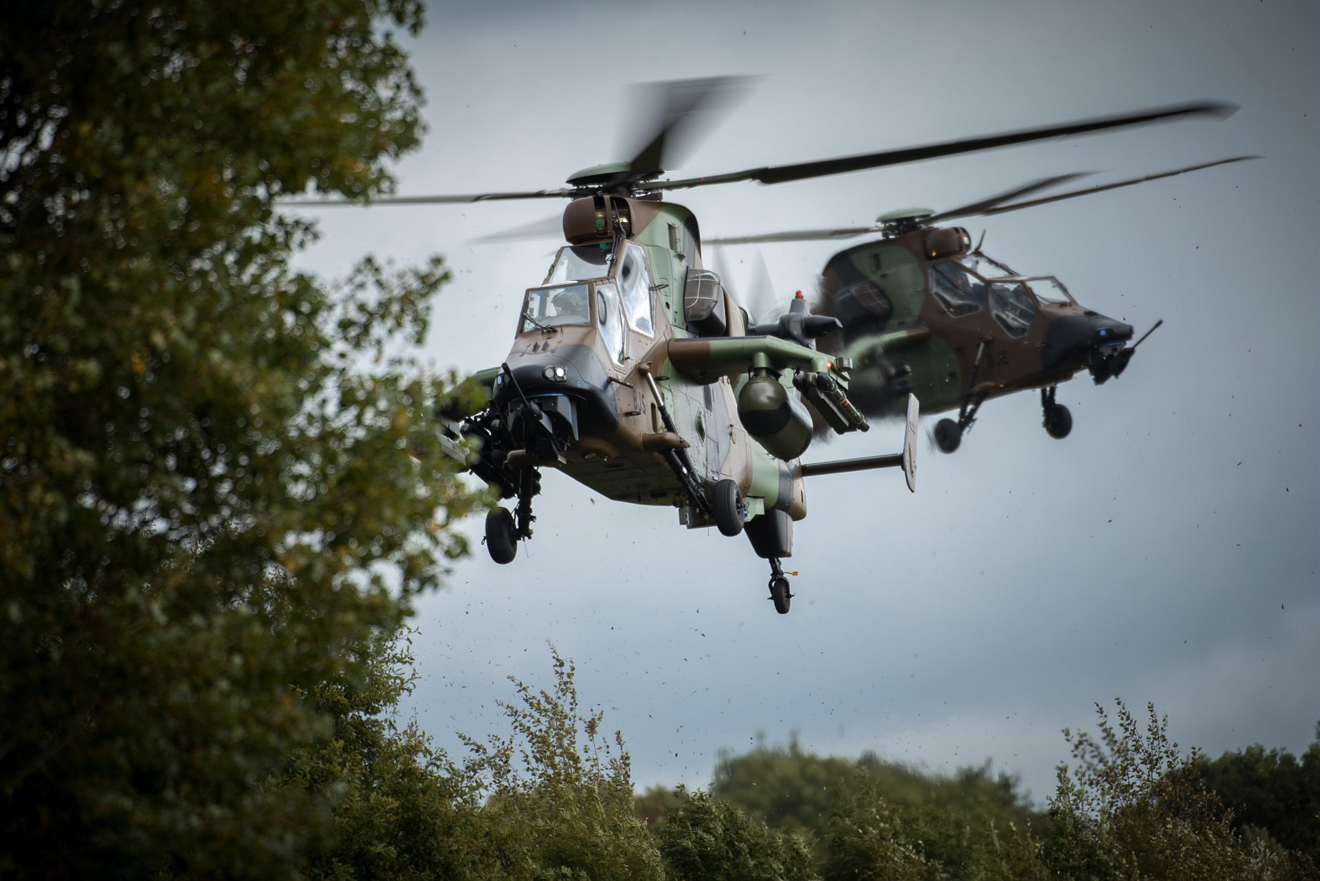 A view of two in-flight Tiger HAD military helicopters.