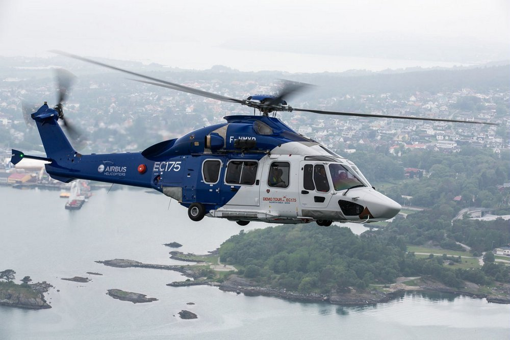 Side view of an in-flight Airbus H175 helicopter configured for aerial work.