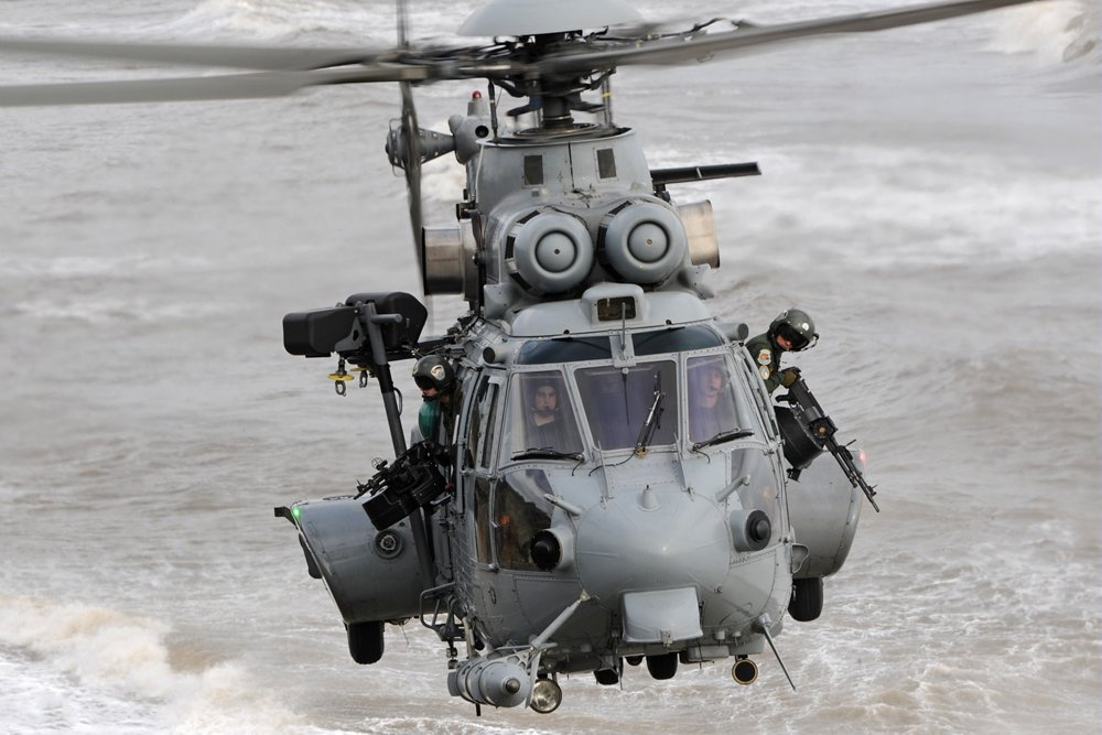 Head-on view of an in-flight Airbus H225M military helicopter.