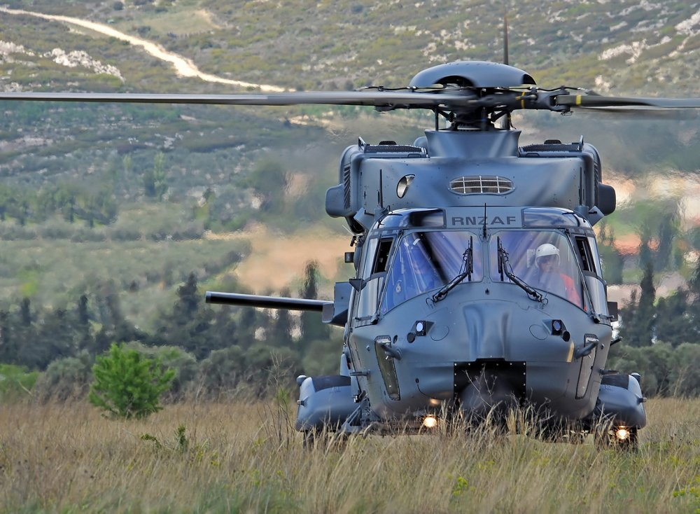 An NH90 military rotocraft, produced by the NHIndustries partnership that includes Airbus Helicopters, is shown on the ground.