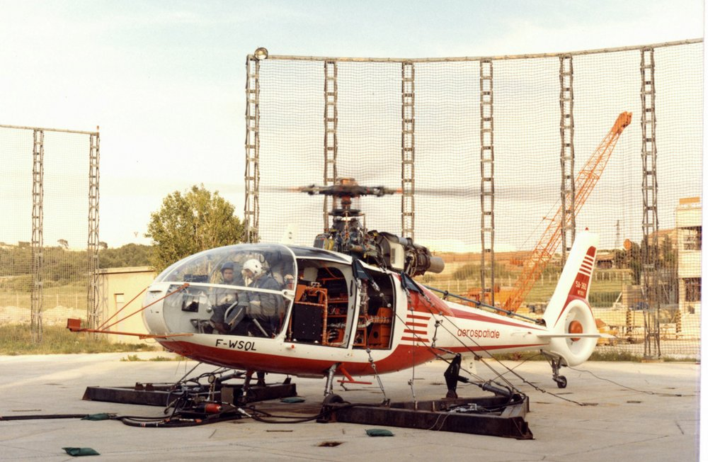 An on-ground photo of the no. 1 SA360 C helicopter, taken in 1972 during engine runup, with rotors turning.