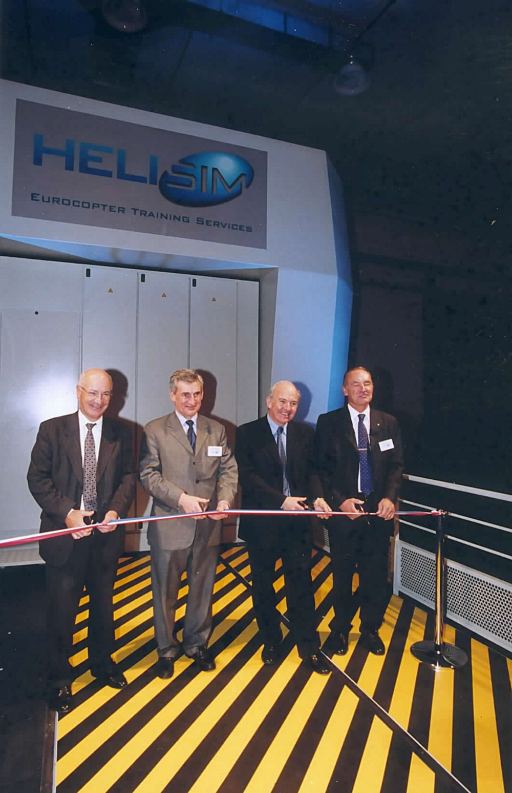 A traditional ribbon cutting during the 2002 inauguration ceremony for Helisim, the simulation centre located at Marseille-Provence International Airport in France.