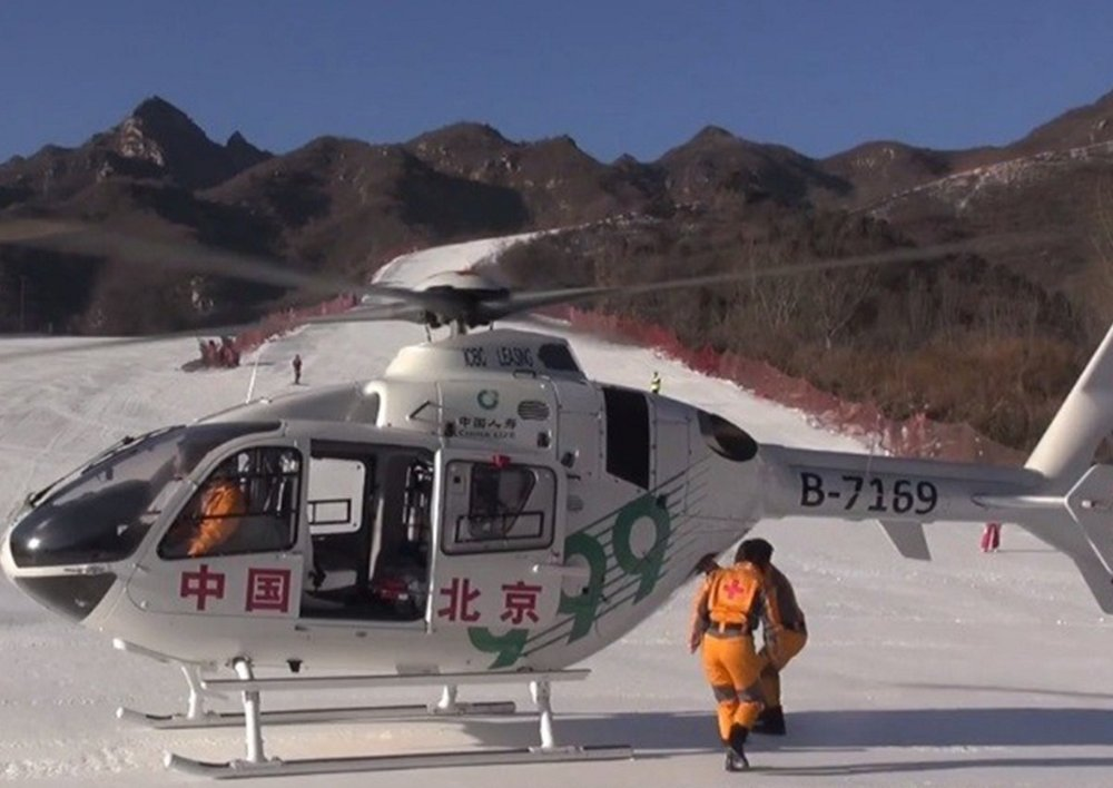 An Airbus H135 helicopter operated by the Chinese Ministry of Public Security shown on snow-covered ground.