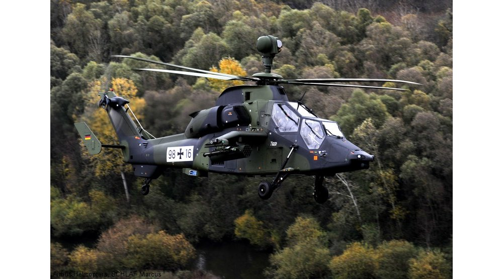 Side view of an in-flight Tiger HAD military helicopter delivered to the German Armed Forces.