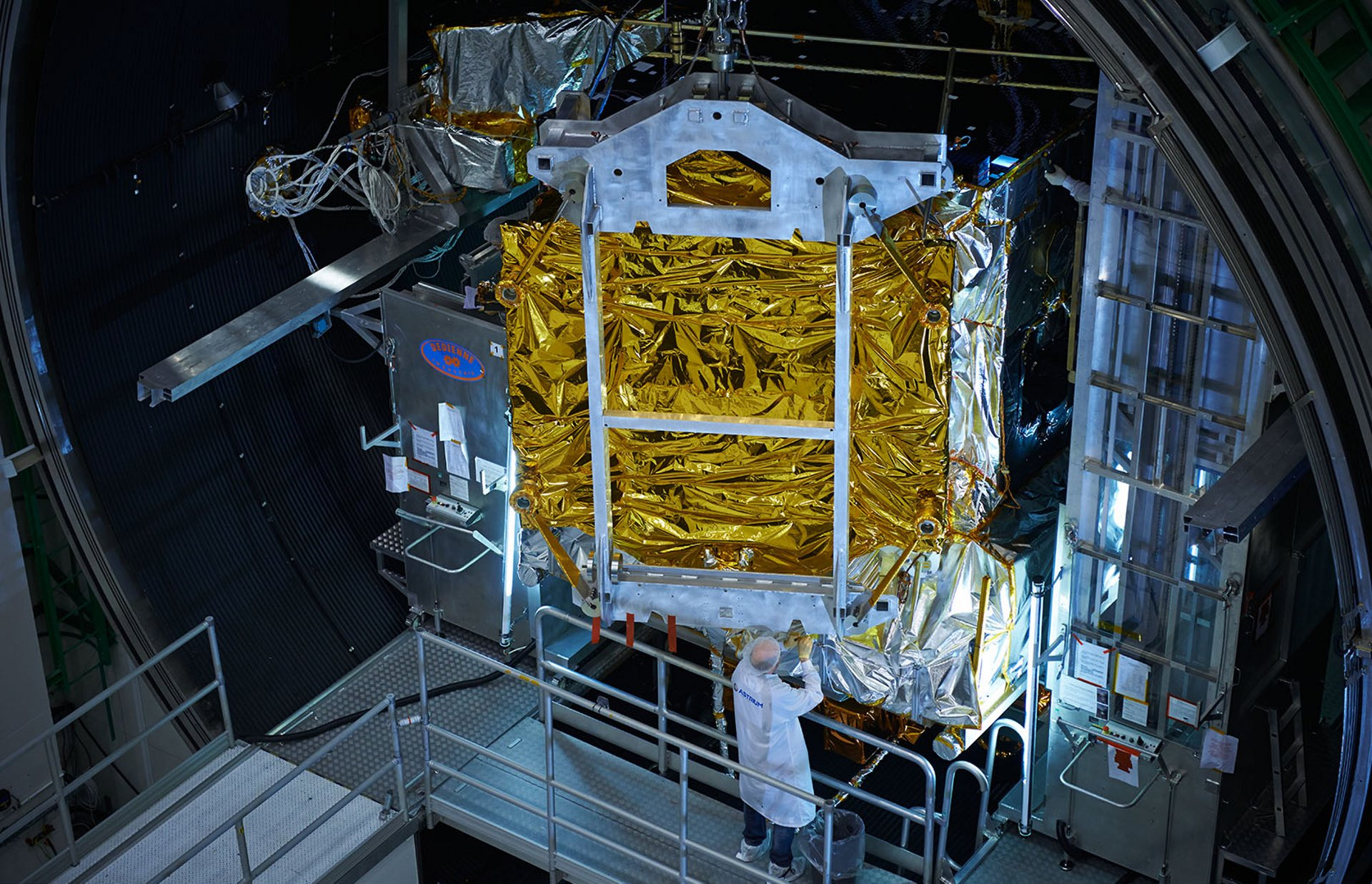 A satellite undergoes evaluations inside one of Airbus' European environmental test centres.