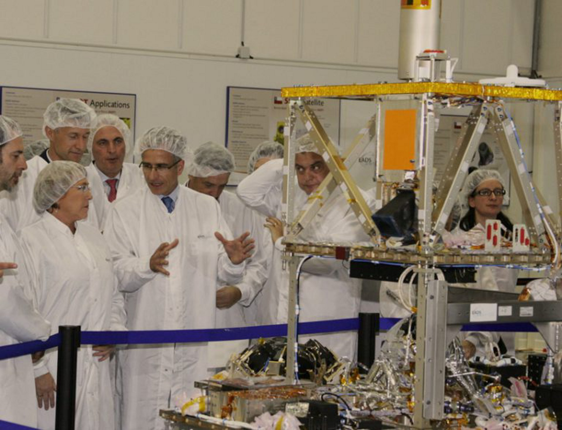 The SSOT (Sistema Satelital de Observación de la Tierra) Earth observation satellite, built by Airbus for Chile, is shown in the clean room during integration.