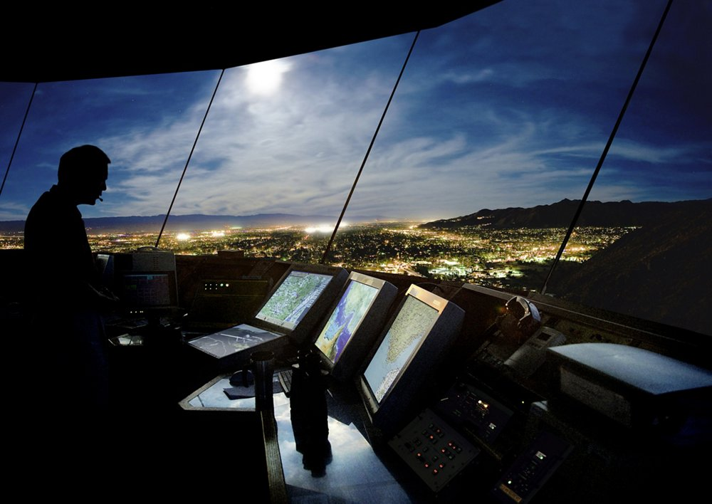 Dramatic view of a satellite ground control station at night.