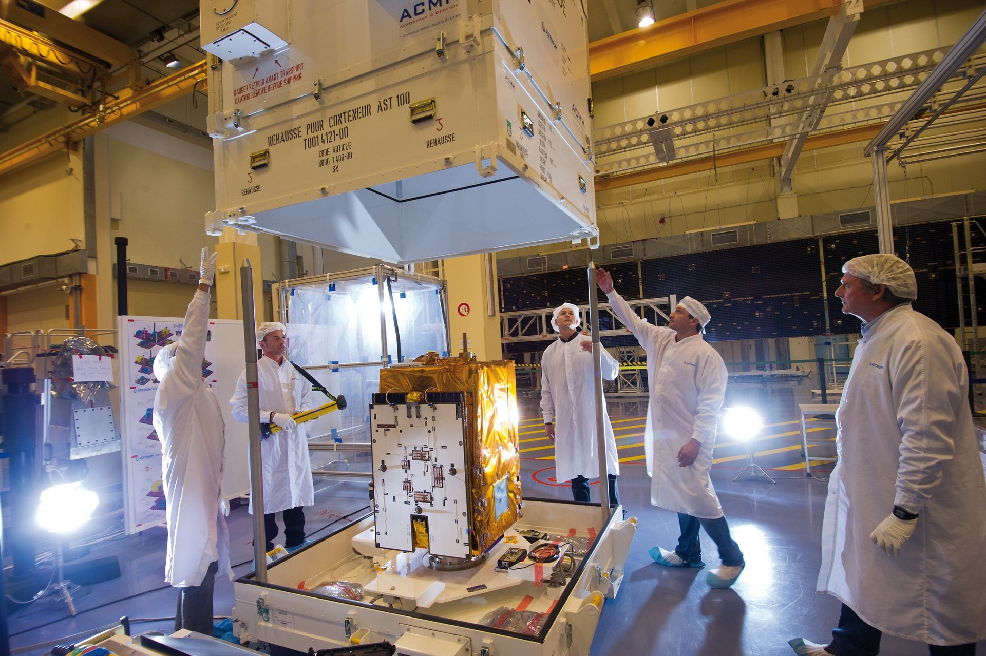 The Airbus-produced VNREDSat-1 Earth observation satellite is removed from its shipping container.