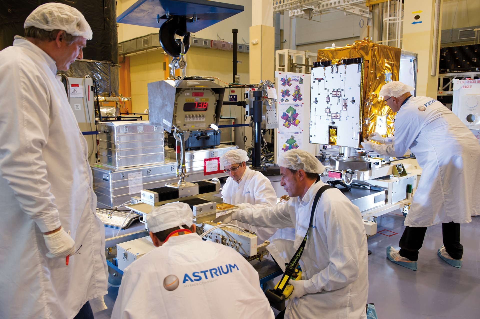 The VNREDSat-1 Earth observation satellite is readied by Airbus engineers.
