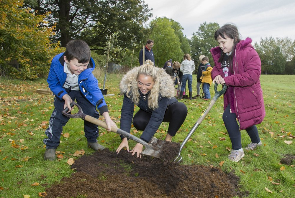 North Wales Wildlife Trust plant apple trees with pupils from Ysgol Derwenfa in Leeswood which is sponsored by Airbus.