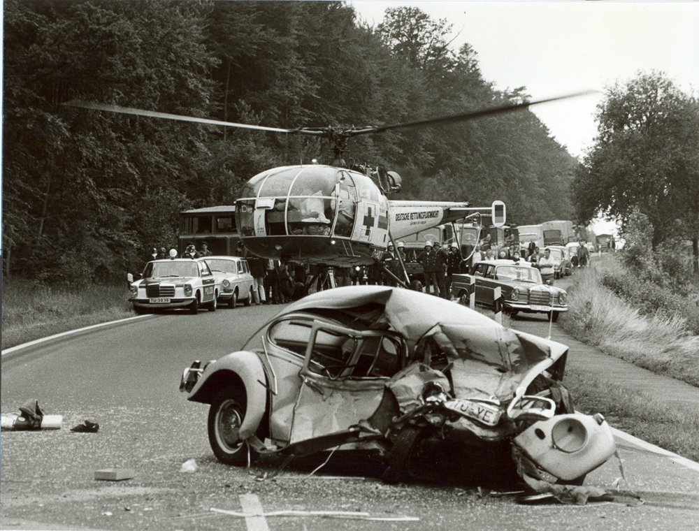 An Alouette III helicopter hovers at a road accident scene in Germany during the 1970s.